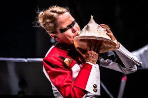 Christine Chapman playing a conch