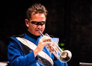 Markus Schwind playing trumpet in costume